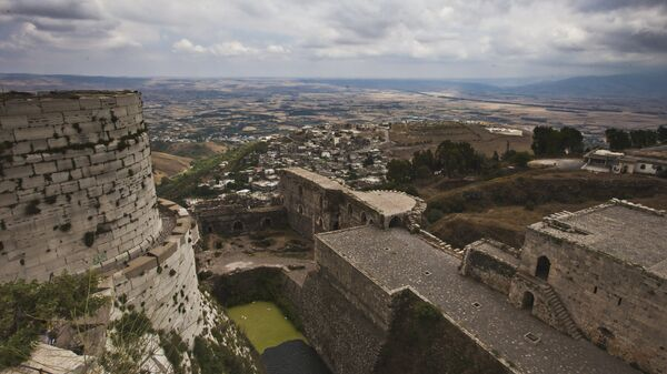 Замок крестоносцев Крак де Шевалье, расположенный в 65 километрах восточнее города Хомса. Архивное фото