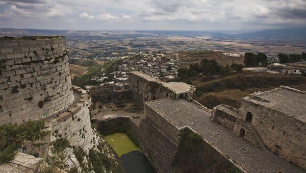 Замок крестоносцев Крак де Шевалье, расположенный в 65 километрах восточнее города Хомса