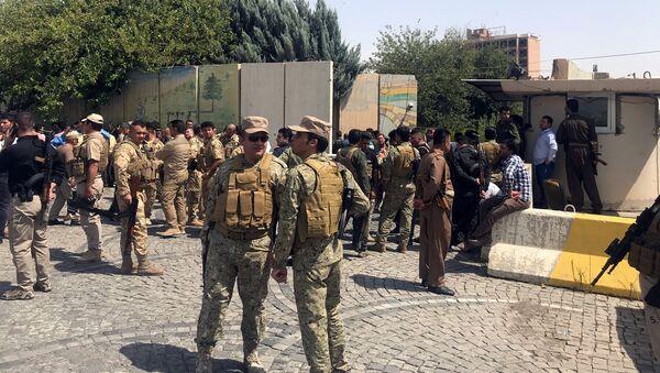 Курдские силы безопасности около здание администрации столицы автономного региона Иракского Курдистана, города Эрбиля. 23 июля 2018