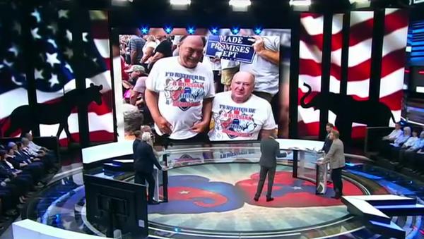 Футболка с надписью Я лучше буду русским, чем демократом в эфире российского телеканала