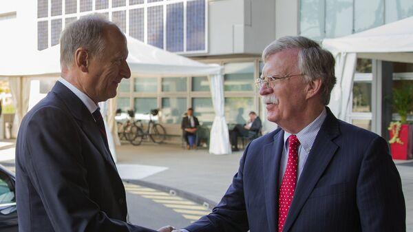 Секретарь Совета безопасности Николай Патрушев и советник президента США по нацбезопасности Джон Болтон во время встречи в Женеве. 23 августа 2018