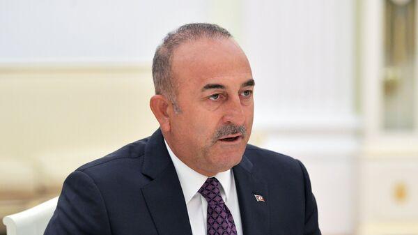 Министр иностранных дел Турции Мевлют Чавушоглу во время встречи с президентом РФ Владимиром Путиным