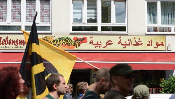 Участники акции против мигрантов в Берлине