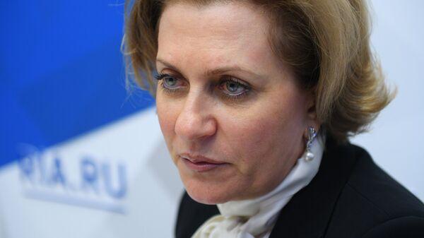 Анна Попова во время интервью на стенде Международного информационного агентства Россия сегодня на IV Восточном экономическом форуме