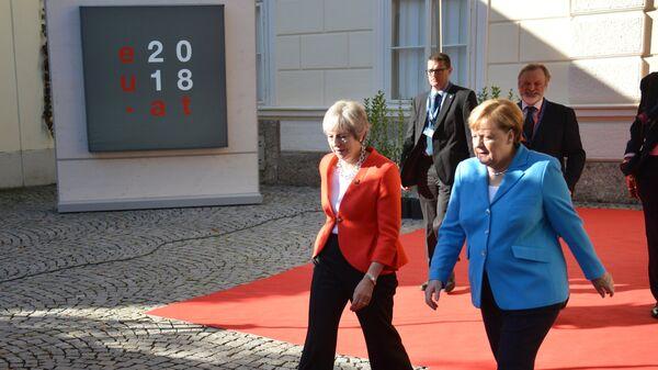 Канцлер ФРГ Ангела Меркель и премьер-министр Великобритании Тереза Мэй в Зальцбурге, Австрия. 20 сентября 2018