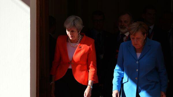 Канцлер ФРГ Ангела Меркель и премьер-министр Великобритании Тереза Мэй. Архивное фото