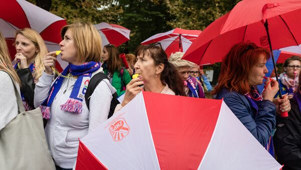 Демонстрацию польских профсоюзов, призывающих к поднятию заработной платы, в Варшаве, Польша. 22 сентября 2018