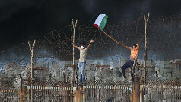 Палестинские протестующие на границе с Израилем
