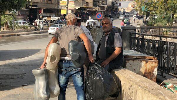 Жители города Хама, Сирия. Архивное фото