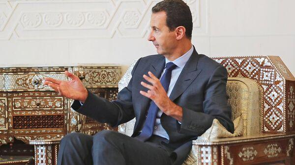 Президент Сирийской арабской республики Башар Асад во время встречи с главой Республики Крым Сергеем Аксёновым в Дамаске. 16 октября 2018