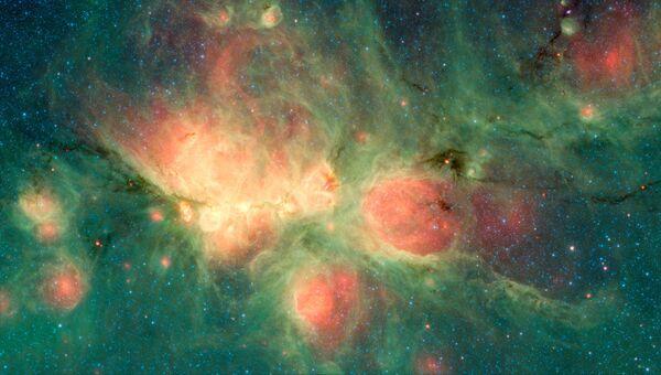 Снимок телескопа Спитцер с изображением туманности Кошачьей лапы