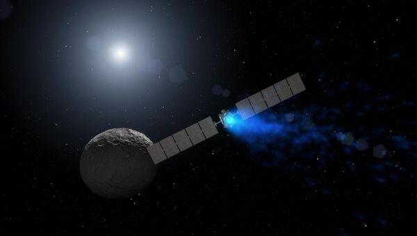 Иллюстрация, показывающая космический аппарат Dawn сближающийся с планетой Церцера. Архивное фото
