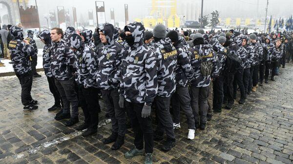 Участники акции за введения военного положения на Украине, организованной партией Национальный корпус в Киеве. 26 ноября 2018
