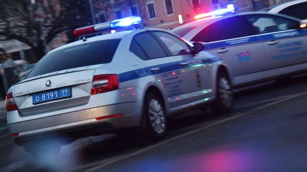Автомобили полиции на дороге. Архивное фото