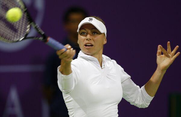 Вера Звонарева в матче с Еленой Янкович на турнире в Дохе