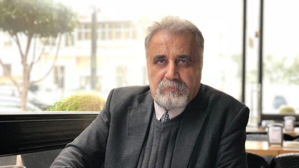 Глава «Сирийской сети по правам человека» Ахмад Казем