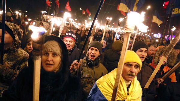 Участники марша националистов, приуроченного к 110-й годовщине со дня рождения Степана Бандеры, в Киеве. 1 января 2019