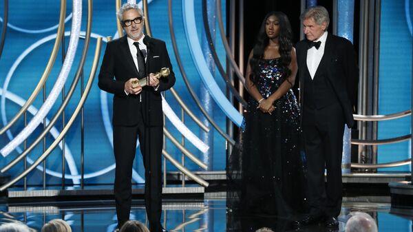 Мексиканский режиссер Альфонсо Куарон на церемонии вручении премии Золотой глобус