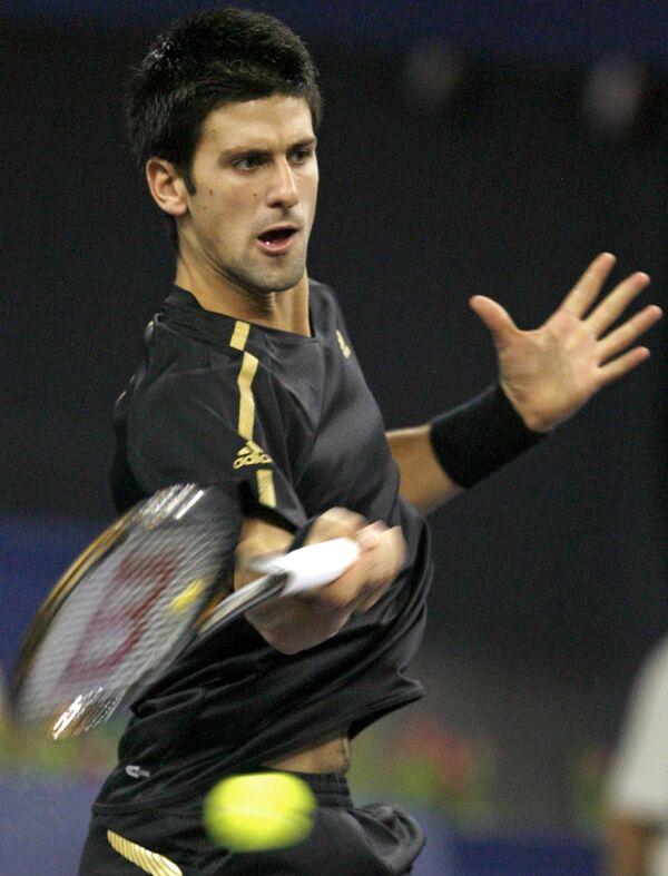 Новак Джокович в матче против Жо-Вильфреда Цонга на итоговом турнире ATP в Шанхае