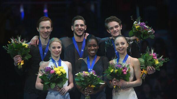 Евгения Тарасова и Владимир Морозов, Ванесса Джеймс и Морган Сипре, Александра Бойкова и Дмитрий Козловский (слева направо)