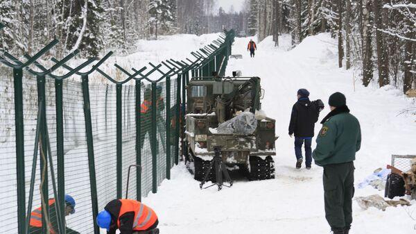 Возведение забора на границе Латвии