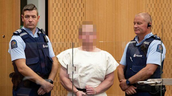 Обвиняемый в массовом убийстве Брентон Таррант в суде города Крайстчерч, Новая Зеландия