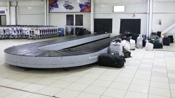В аэропорту Триполи Митига после столкновений, Ливия