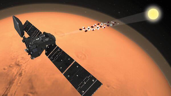 Так художник представил себе работу зонда ЭкзоМарс-TGO на Марсе