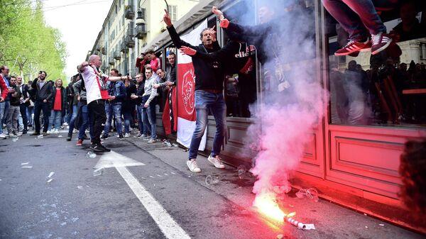 """Столкновения фанатов """"Аякса"""" с полицией произошли в Турине"""