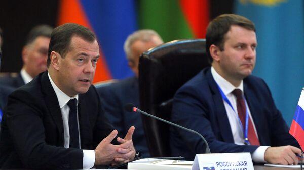 Председатель правительства РФ Дмитрий Медведев и министр экономического развития РФ Максим Орешкин  во время заседания Евразийского межправительственного совета в расширенном составе. 30 апреля 2019