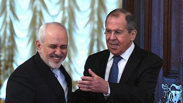 Министр иностранных дел РФ Сергей Лавров и министр иностранных дел Исламской Республики Иран Мухаммад Джавад Зариф во время встречи в Москве. 8 мая 2019