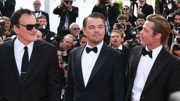 Режиссер Квентин Тарантино, актеры Леонардо ДиКаприо и Брэд Питт  на красной дорожке фильма Однажды... в Голливуде в рамках 72-го Каннского международного кинофестиваля.