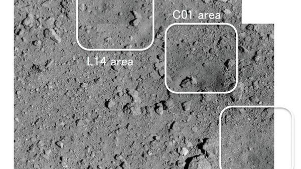 Высококачественная фотография рукотворного кратера (С01) на астероиде Рюгю,  полученная зондом Хаябуса-2