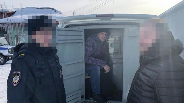 Обвиняемый Руцкий во время следственного эксперимента