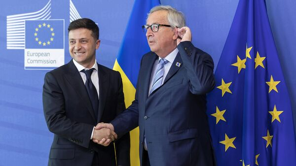 Президент Украины Владимир Зеленский и председатель Европейской комиссии Жан-Клод Юнкер во время встречи в Брюсселе. 4 июня 2019