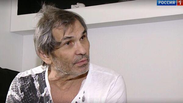 Стоп-кадр из первого интервью Бари Алибасова после отравления