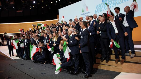 Italian delegation celebrates after International Olympic Committee (IOC) president Thomas Bach from Germany announced that Milan-Cortina was chosen to host the 2026 Winter Olympic Games
