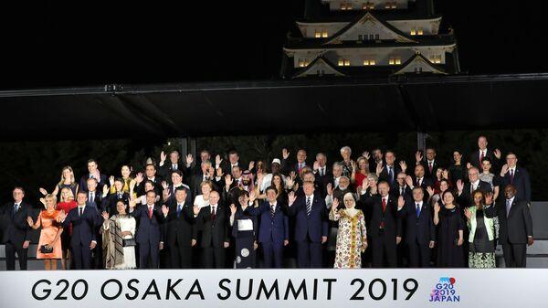 Президент РФ Владимир Путин на церемонии совместного фотографирования глав делегаций государств – участников саммита Группы двадцати. 28 июня 2019