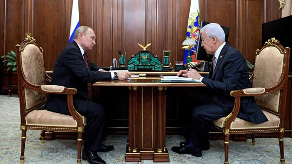 Президент РФ Владимир Путин и глава Дагестана Владимир Васильев во время встречи. 8 июля 2019