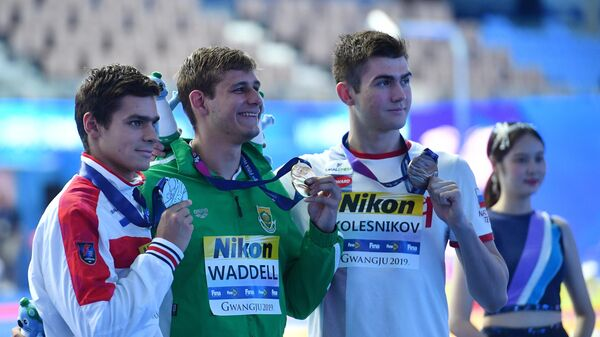 Евгений Рылов (слева), Зейн Уодделл и Климент Колесников (справа)