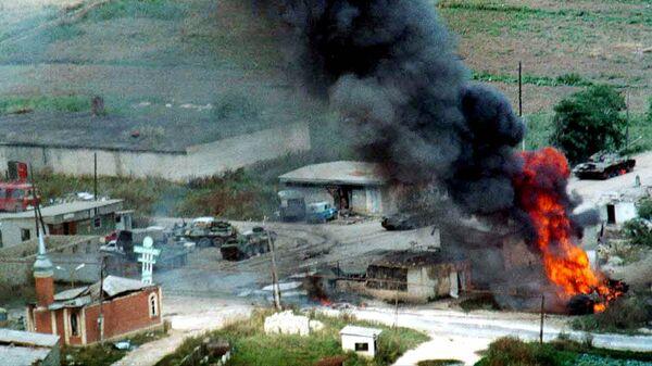 Подожженный российский танк в селе Карамахи, Дагестан
