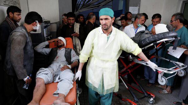 Раненый мужчина после взрыва в Кабуле, Афганистан. 7 августа 2019