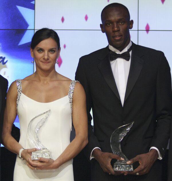 Елена Исинбаева и ямайский спринтер Усэйн Болт