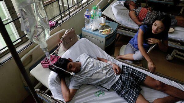 Пациенты с лихорадкой денге в больнице Сан-Лазаро в Маниле, Филиппины