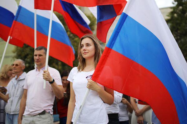 Участники празднования Дня государственного флага Российской Федерации в Краснодаре