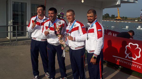 Российские гребцы Алексей Востриков, Игорь Калашников, Олег Синявин и Василий Погребан (слева направо)