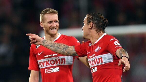 Андре Шюррле (слева) и Андрей Ещенко