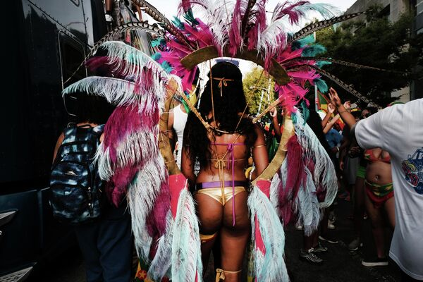 Участница фестиваля карибской культуры в Нью-Йорке