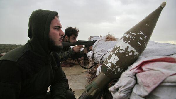 Сирийские бойцы, поддерживаемые Турцией, удерживают позиции около города Таль-Хаджар в нескольких километрах от районов, контролируемых курдской коалицией. 1 февраля 2019
