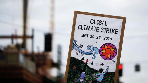 Плакат во время климатической забастовки в Сиэтле. 20 сентября 2019